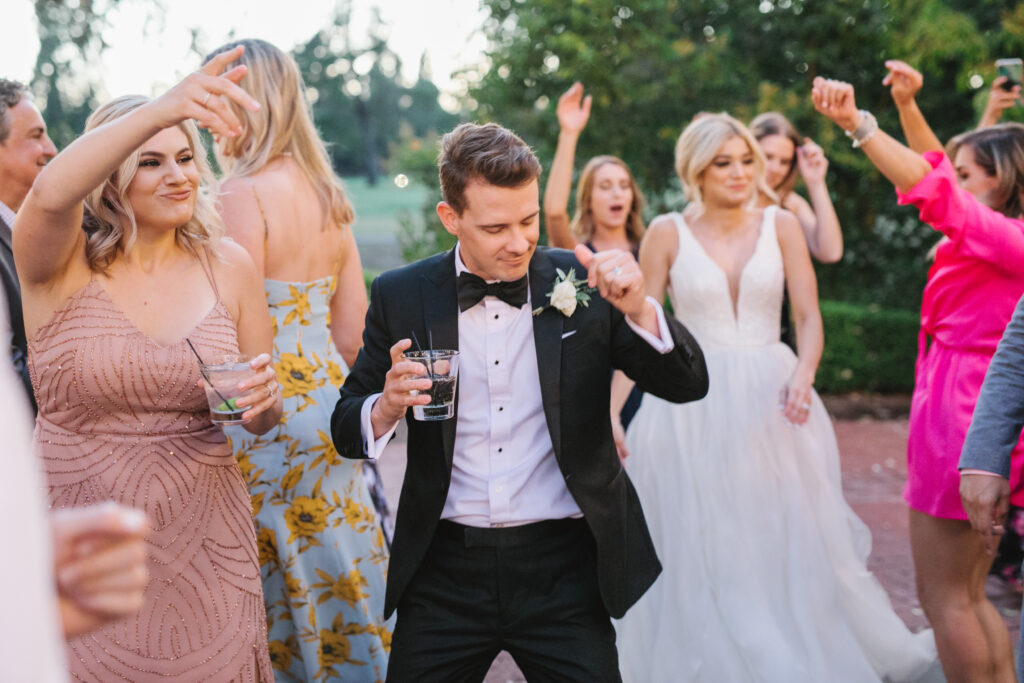 Groom dancing at his destination Napa Valley wedding at Silverado Resort and Spa