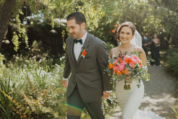 Bride and groom exiting their garden wedding ceremony