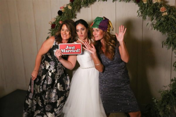 Bride and guests having fun in the photobooth at wine country wedding!