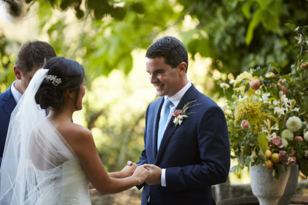 Exchanging vows at their winery wedding at Vine Hill House